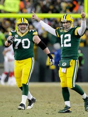 Green Bay Packers quarterback Aaron Rodgers (12) celebrates