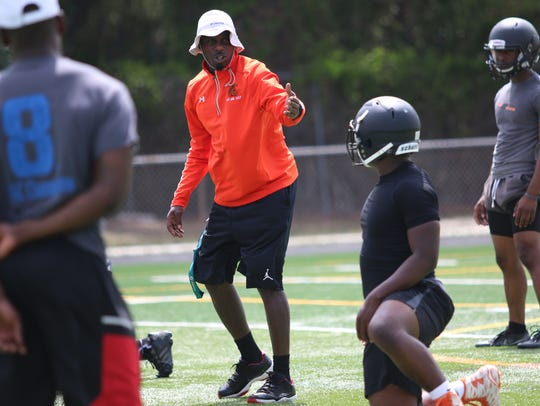 Interim Lely High School football head coach Fritz Jacques leads players through drills and instruction during the first spring practice of the season in 2017. This fall season, Lely will have its seventh head football coach in 12 seasons.