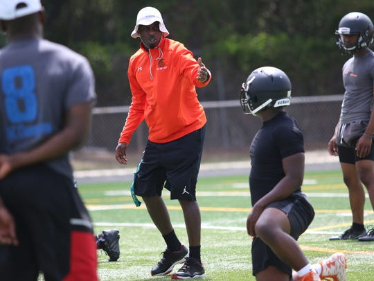 Interim Lely High School football head coach Fritz Jacques leads players through drills and instruction during the first spring practice of the season on April 24, 2017. This fall season, Lely will have its seventh head football coach in 12 seasons.