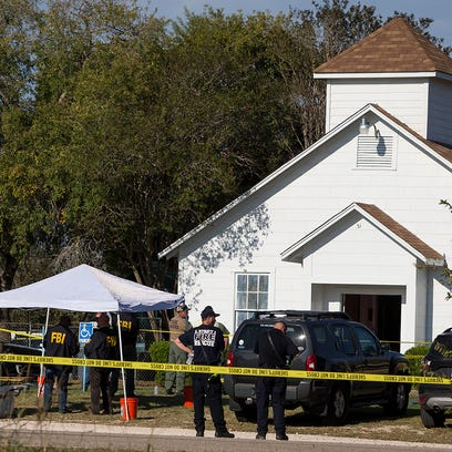 Law enforcement officials works at the scene of a fatal