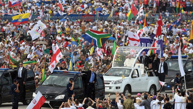 Francis waves from the Papamobile upon his arrival to celebrate a Mass for World Youth Day at the Campus Misericordiae in Brzegi, Poland, on July 31, 2016.