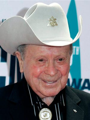 "In this file photo, Grand Ole Opry star Little Jimmy Dickens arrives at the 40th Annual CMA Awards in Nashville, Tenn. Dickens has been hospitalized with an undisclosed illness. Jessie Schmidt, a publicist for the Opry, said in a news release Sunday that Dickens was admitted to a Nashville-area hospital on Dec. 25 and that he's in ""critical care."""