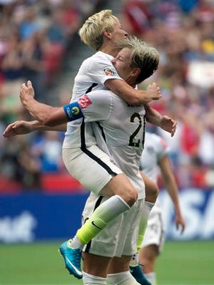 United States' Abby Wambach celebrates her goal with teammate Megan Rapinoe during the first half of a FIFA Women's World Cup soccer match, Tuesday, June 16, 2015 in Vancouver, New Brunswick, Canada (Jonathan Hayward/The Canadian Press via AP) MANDATORY CREDIT
