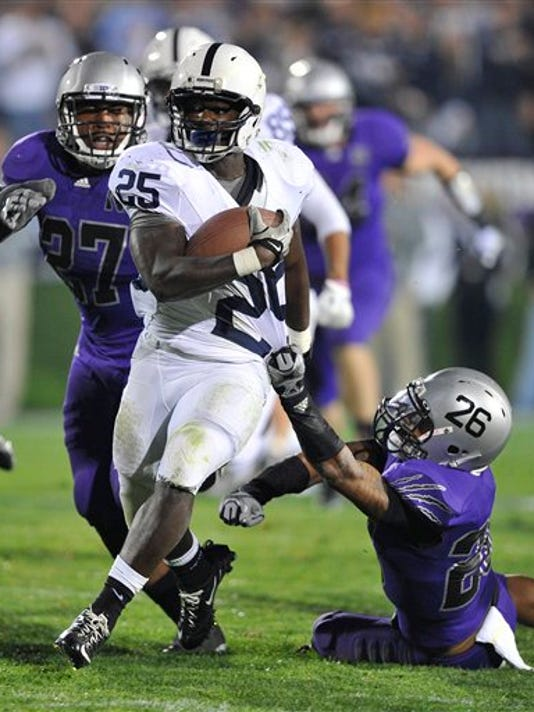 Penn State's Silas Redd (25) runs upfield as Northwestern players give chase. The Nittany Lions beat the Wildcats, 34-24.