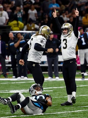 New Orleans Saints kicker Wil Lutz (3) celebrates after kicking the game winning field goal in the second half of an NFL football game against the Carolina Panthers in New Orleans, Sunday, Oct. 16, 2016. The Saints won 41-38. (AP Photo/Bill Feig)