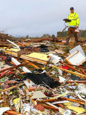 In this Nov. 30, 2016, photo, Bob Wright looks for personal belongings after a suspected tornado ripped through the town of Rosalie, killing three of his brother's family members in Rosalie, Ala. The most extreme tornado outbreaks, like the deadly one Tuesday in the Southeast, are mysteriously spawning many more twisters than they did decades ago, a new study claimed. The same type of once-every-five-years-or-so outbreak that 50 years ago had about 12 tornadoes, now has on average about 20, said Columbia University applied physics professor Michael Tippett, lead author of the study in Thursday's journal Science.