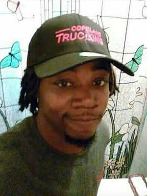 FILE - This undated file photo released by Javille Burns shows her brother, Jamar Clark, who was shot Nov. 15, 2015, after a confrontation with two police officers and died a day later. A jury on Wednesday, Feb. 1, 2017, convicted Allen Scarsella, a Minnesota man, of assault for opening fire and wounding five black men demonstrating against the fatal shooting of Clark.