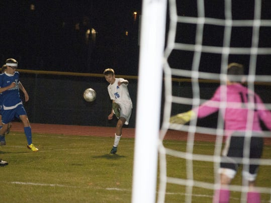 McConnellsburg's Ethan Barclay cranks up a shot that found the back of the net for the Spartans' fourth goal in a 5-1 victory over Windber in a District 5-A quarterfinal game Saturday night.