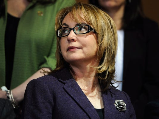 Former Arizona U.S. Rep. Gabby Giffords listens, during a news conference at the state Capitol, Tuesday, March 17, 2015, in Hartford, Connecticut. Giffords was on hand to help promote the latest gun control proposals offered since the Newtown school shootings in the state. (AP Photo/Jessica Hill)