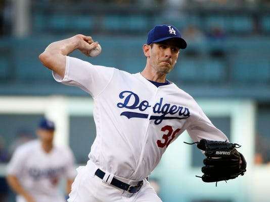 Los Angeles Dodgers starting pitcher Brandon McCarthy throws against the New York Mets during the first inning of a baseball game, Tuesday, June 20, 2017, in Los Angeles. (AP Photo/Jae C. Hong)