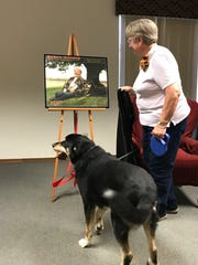 Susan and Sunny unveils their READ poster at Muehl Public Library.