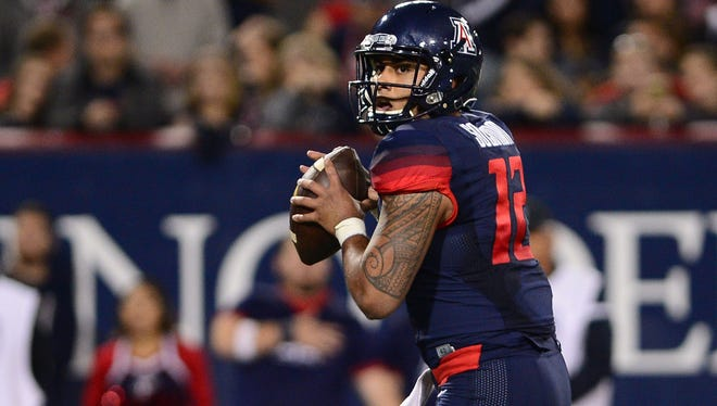 Anu Solomon drops back to pass agaisnt Utah at Arizona Stadium.