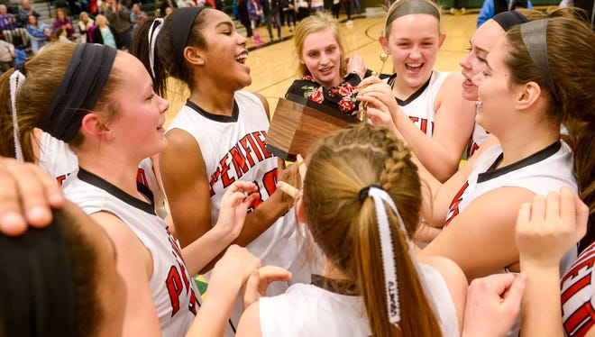 The Penfield girls basketball team celebrates after winning the Section V Class AA Championship on Feb. 27, 2016.