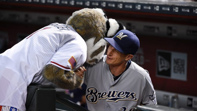 Brewers manager Craig Counsell gets a hug from Diamondbacks mascot Dbaxter prior to Friday's game. Counsell played six seasons in Arizona.