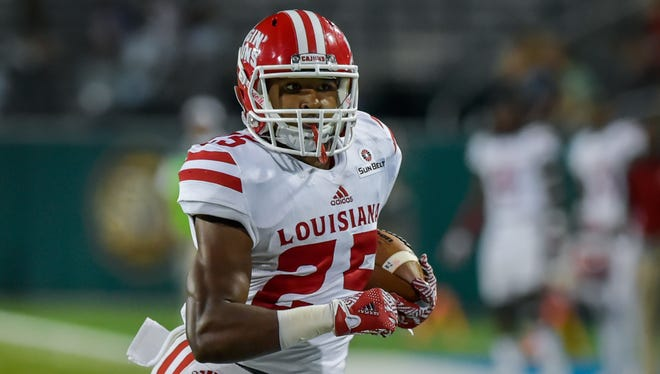 UL running back Raymond Calais, shown here against Tulane earlier this season, will miss the New Orleans Bowl due to shoulder surgery.