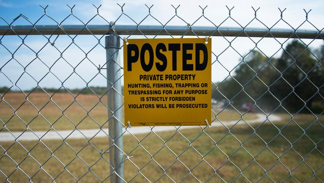 A posted sign hangs on a fence surrounding the 95-acre property of Todd Kohlhepp in Woodruff on Thursday, November 3, 2016.