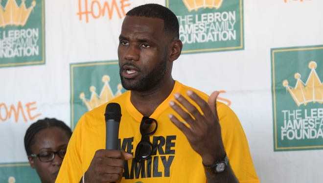 "LeBron James speaks with reporters following the LeBron James Family Foundation ""I Promise"" reunion event Thursday, Aug, 13, 2015, at Cedar Point in Sandusky, Ohio. James is giving kids from Akron--ones with challenging backgrounds like his--the chance to go to college for free. The NBA star has partnered with the University of Akron to provide a guaranteed four-year scholarship to the school for students in James' ""I Promise"" program who qualify. The scholarship will cover tuition and the university's general service fee--currently $9,500 per year."