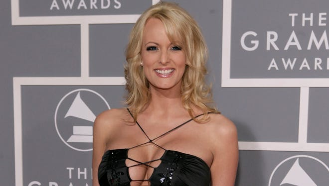 In this 2007 file photo, adult film actress Stormy Daniels arrives for the 49th Annual Grammy Awards in Los Angeles.