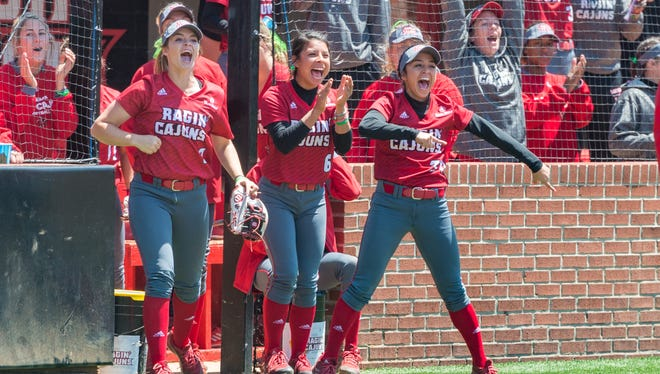 UL Ragin' Cajuns players cheer on a big hit during the team's Sun Belt Conference split Sunday with league-leading Texas State. The two teams will play the rubber game of the series at 11 a.m. Monday with free admission at Lamson Park.