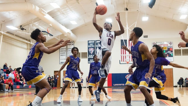 TJ Jones takes a shot as Lafayette Christian Academy takes on Rayne High School in The LCA Showcase Classic Tournament. Wednesday, Dec. 19, 2018.