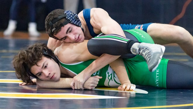 Teurlings Catholic's Austin Pratt gets the win over Lafayette High's Allen Cortez to help the Rebels win the Greg Lavergne Parish Duals Championships on Saturday at Carencro High.