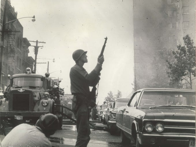 A National Guardsman holds a rifle during the Newark