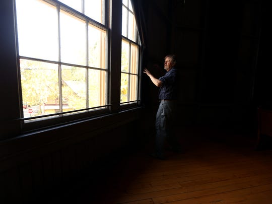 Promoter George Philhower opens up the curtains inside