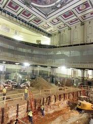 Workers excavate the floor of Springer Auditorium,
