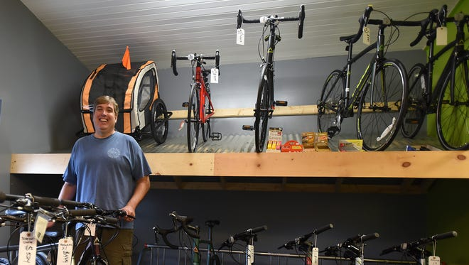 Doug Berling, owner of Freedom Bicycles in Alexandria, in the businesses showroom. Customers to the full service bicycle shop can also rent fitness bikes, traditional beach cruisers and electric bikes.