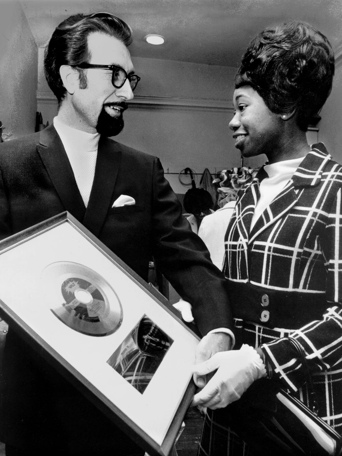 "Stax Records president Jim Stewart presents Zelma Redding, wife of Otis Redding, with a gold record for ""Dock Of The Bay"", which was recorded at Stax four days before the late ""King of the Memphis Sound"" died in a Wisconsin plane crash."