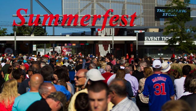 A crowd gathers outside the south entrance at Summerfest in Milwaukee, one of the world's largest music festivals. Festival organizers are assessing their security plans following the attack at the Route 91 Harvest festival in Las Vegas on Sunday, the worst mass shooting in modern U.S. history.