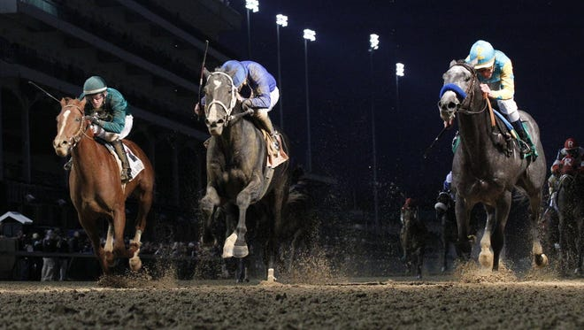 In this photo provided by Churchill Downs, El Kabeir, right, ridden by jockey Calvin Borel, wins the 88th running of the $233,000 Kentucky Jockey Club horse race ahead of Imperia, center, and Eagle, left, at Churchill Downs, Saturday, Nov. 29, 2014.