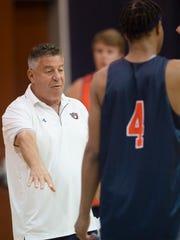 Auburn head coach Bruce Pearl coaches during the first practice of the 2017-2018 NCAA Basketball Season on Friday, Sept. 29, 2017, in Auburn, Ala.