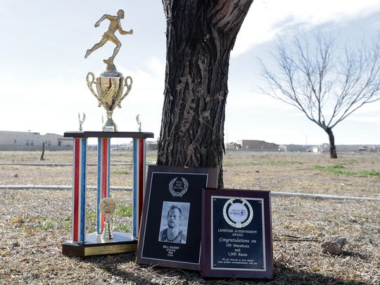 A few of Bill Barry's many trophies including a plaque