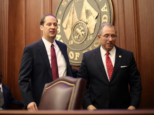 Sen. Joe Negron, left, who officially took his position as president of the Florida Senate, stands with Martin County Sheriff William Snyder in the Senate chamber at the Capitol in Tallahassee on Tuesday, Nov. 22, 2016.