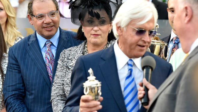 American Pharoah owner Ahmed Zayat, left, looks on as trainer Bob Baffert adresses the crowd at Churchill Downs, Saturday, June 13, 2015. (Timothy D. Easley/Special to the C-J)