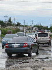 Motorists drive through the Harmon Industrial Park road.