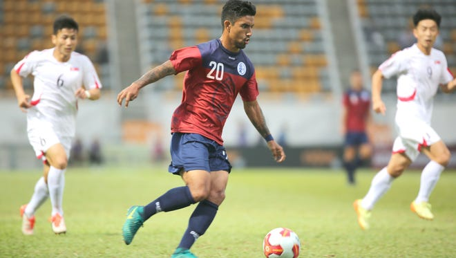 Guam's A.J. DeLaGarza makes his way to the goal against DPR Korea in this file photo from the most recent edition of the EAFF E-1 Football Championship Semifinal Round at the Mong Kok Stadium in Hong Kong.
