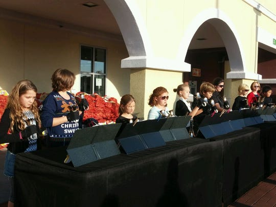 Gulf Breeze Elementary School fourth- and fifth-graders performed with handbells outside Publix in Gulf Breeze.