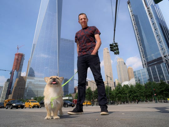 Dion Leonard and his dog, Gobi, pose for a photo in New York on June 14, 2017.
