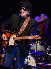Merle Haggard opened the night with his band, The Strangers, then joined Willie Nelson as a guitarist for half of his set.