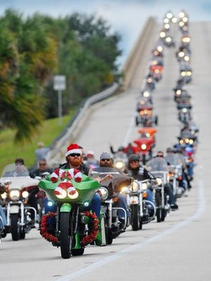 2014 FILE PHOTO: Thousands of motorcycle enthusiasts head west over the Hubert Humphrey Bridge in Cocoa during the annual ABATE toy run Sunday afternoon at Merritt Square Mall.