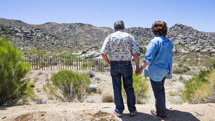 Lee and Diane Helm look from their ranch toward the