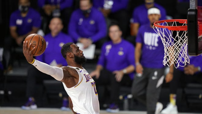Los Angeles Lakers' LeBron James (23) dunks during the NBA Finals on Oct. 11 in Lake Buena Vista, Fla.