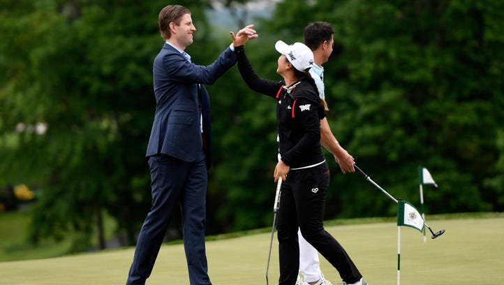 Eric Trump high-fives Lydia Ko, pro-golfer, while at