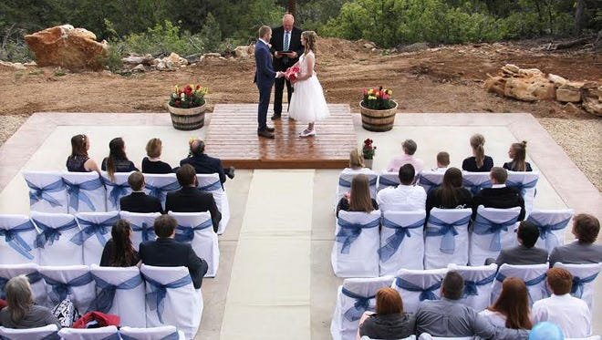 A couple exchanges vows during their wedding ceremony at the Zion Ponderosa Ranch Resort. Not all couples favor a large, elaborate wedding.