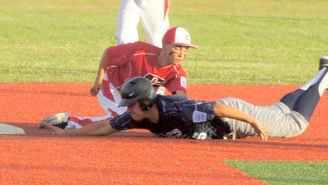Copper League All-Star short stop Izzy Mathis applies the tag to a sliding Silver City All Star base runner during Tuesdays Junior Division (13-14) contest at the District 7 Little League Tournaments at E.J. Hooten Park in Deming.