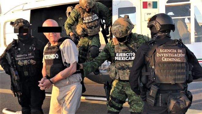 Damaso Lopez, reputed to be Chapo Guzman's right-hand man, was handed over Friday by Mexican authorities in Juarez to the U.S. government.