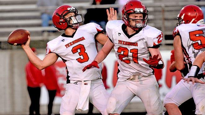 Tekonsha's Wyatt Blashfield (3) looks for an open receiver while teammate Isaac Henry (21) provides some protection Friday. Blashfield accounted for four touchdowns rushing on the night.