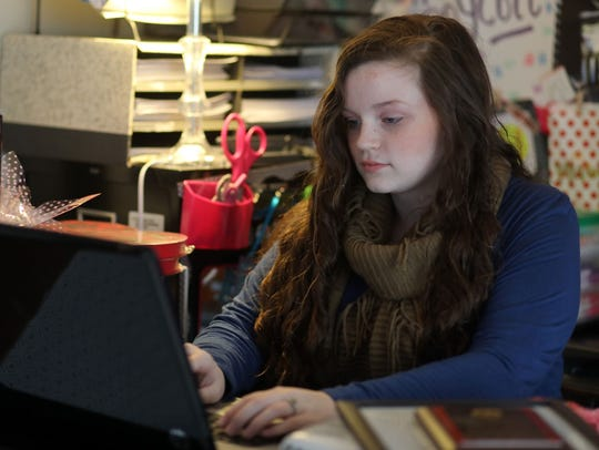 Sydnee Floyd, seen here building a website for a new nonprofit she's forming, is one of two state honorees for the country's largest youth recognition program that's based solely on volunteer community service